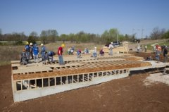 Habitat for Humanity volunteers begin work on one of two homes being built during the RV Care-A-Vanner 25th anniversary celebration in Springfield, Mo