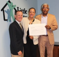 (Little City Chief Development Officer Ed Hockfield, ShirleyAnn M. Robertson and Little City Executive Director Shawn E. Jeffers)