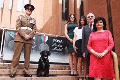 Sergeant Major Andy Dodds and Fire with members of the late Lance Corporal Kenneth Rowe�s family