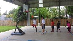 Coach Murphy runs the students at Bridge through some layups.