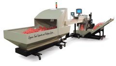 New Ergocon Towel Inspection and Packaging System packages up to 7000 clean towels per hour.