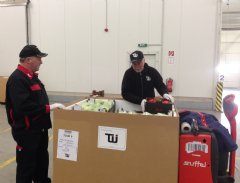 TWI personnel package fresh fruits and vegetables at our Frankfurt distribution facility for delivery to US customers operating in Niger.