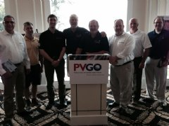 TWI representatives pose with attendees and directors of the Paralyzed Veterans Golf Open.