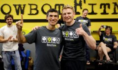 Charles Anderson (left) and Stephen Ebbett (right) celebrate the completion of their World Record Row at Rowbot Fitness on June 1, 2014