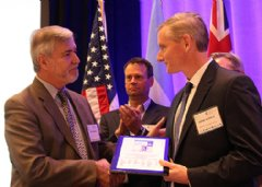 Accepting the award was Jim McHale, Ph.D., American Standard vice president of research, development and engineering, pictured on the right.